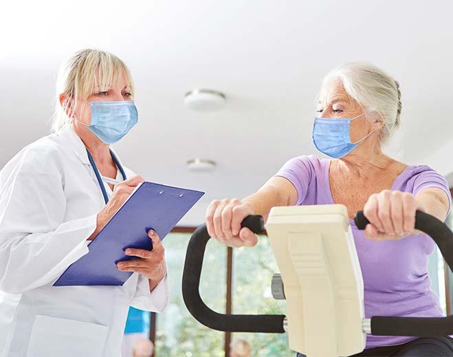 elderly woman doing cardiac rehab