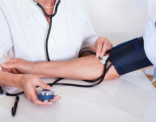 person getting blood pressure checked